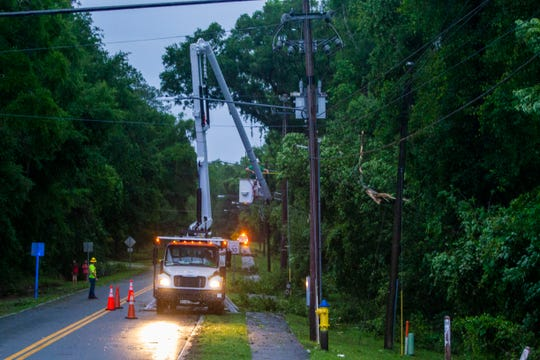 A power line crew works to restore power after a strong thunderstorm that likely produced tornadoes came through Tallahassee Thursday evening, April 23, 2020.