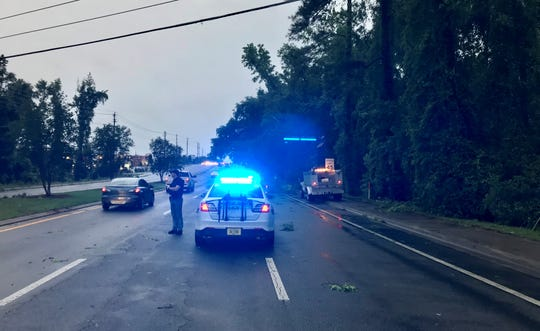 Crews remove downed limbs from Thomasville Road in Bradfordville, where an unconfirmed tornado went through Thursday night.