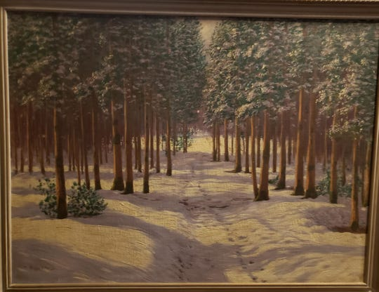 Vero Beach native Monica Maria Tetzlaff donated this painting of a presumably Hungarian landscape to Temple Beth Shalom in Vero Beach. The painting, taken from Jews deported by Nazis to gas chambers in 1944, will sit in the hallway of children's classrooms.