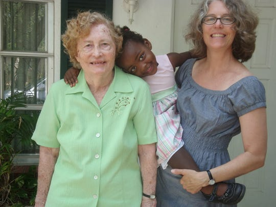 Mary Tetzlaff, left, and her daughter, Monica Maria Tetzlaff, flank Monica's adopted daughter, Hannah, in this 2011 photo taken outside Mary's Jasmine Lane home in Vero Beach.