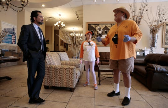 Salvador Perches, left, owner of Perches Funeral Homes, talks with Operation H.O.P.E. founder Angel Gomez and Patsy Gomez as they prepare to offer discounted or free funerals for coronavirus victims in El Paso, Las Cruces and Juárez.