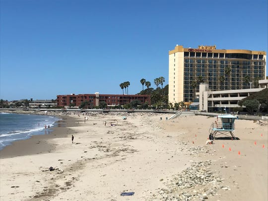 People flocked to the beach in Ventura but appeared to keep a safe distance apart as a heat wave rolled through the area Friday, April 24, 2020.