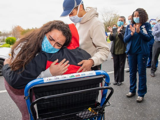 As he is discharged from the Inspira Medical Center Vineland, Miguel Veragallardo receives a hug from his daughter, Grecia, as his son, Miguel, waits his turn for a hug.
