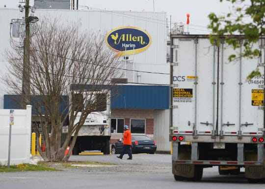 A worker enters the Allen Harim chicken processing plant in Harbeson Thursday.
