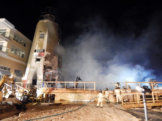 Firefighters from Rehoboth Beach, Bethany Beach and Lewes battled a blaze at the Lighthouse Restaurant on Dickinson Street and the Bay in Dewey Beach on Thursday evening. At about 10 p.m. crews arrived to find the two-story building well involved in fire and partially collapsed. Firefighters were on the scene for more than three hours. No Injuries were reported. The Delaware State Fire Marshal's Office is investigating.