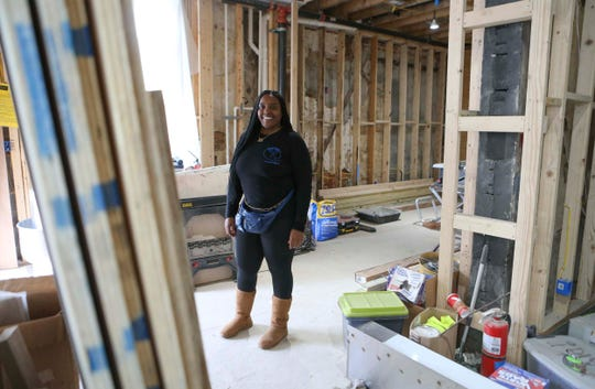 Charly Evol Bass is waiting for the restart of work on her Jerry Deen's restaurant - named for her mother - at Seventh and Church streets in Wilmington's East Side neighborhood, adjacent to the Swedes Church complex.