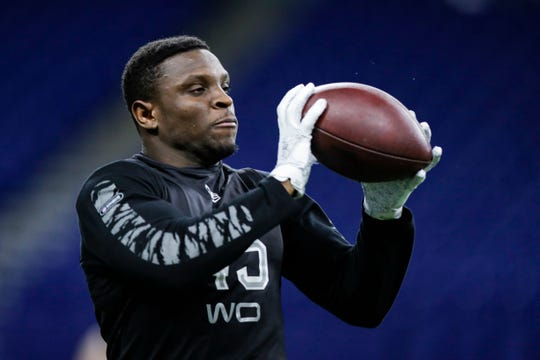 TCU wide receiver Jalen Reagor runs a drill at the NFL football scouting combine in Indianapolis.
