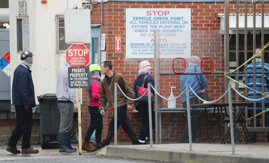 Workers enter the Perdue chicken processing plant in Georgetown Thursday.