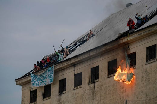 Inmates from Villa Devoto Prison burn mattresses during a riot demanding measures to prevent the spread of the coronavirus, after Covid-19 cases were allegedly confirmed inside the prison, in Buenos Aires on April 24, 2020.