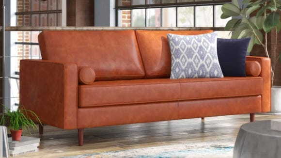 This leather sofa is one of several options on sale right now.