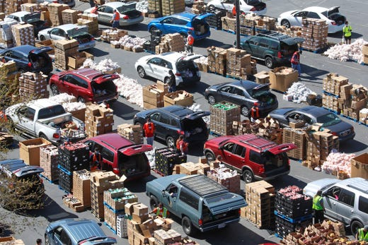Cars line up for food at the Utah Food Bank's mobile food pantry at the Maverik Center, Friday, April 24, 2020, in West Valley City, Utah. As coronavirus concerns continue, the need for assistance has increased, particularly at the Utah Food Bank.