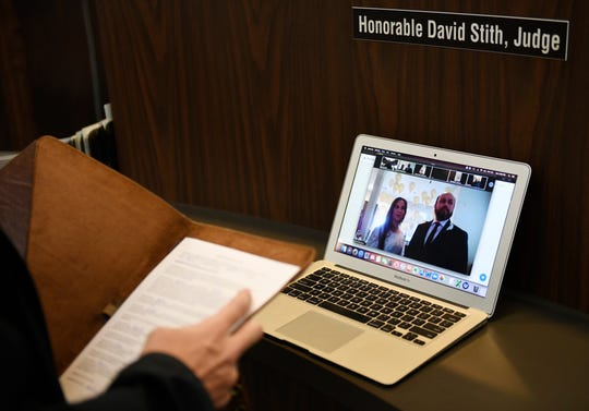 """Judge David Stith begins the Zoom wedding ceremony for Nina and Mario Olivarez, Saturday, April 25, 2020, at the Nueces County Courthouse.""""I thought, man instead of canceling your wedding,"""" Stith says, """"this is a way for people to still be together and to have that special day.""""Ê"""