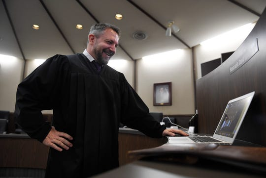 Judge David Stith officiates a wedding via Zoom, Saturday, April 25, 2020, at the Nueces County Courthouse. The district judge marries couples online as a result of coronavirus.
