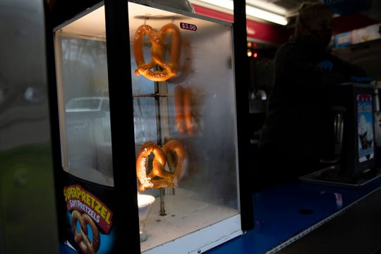 Soft pretzels spin as Skelly's Amusements sells drive-thru carnival food Friday, April 24, 2020 in Williamstown, N.J.