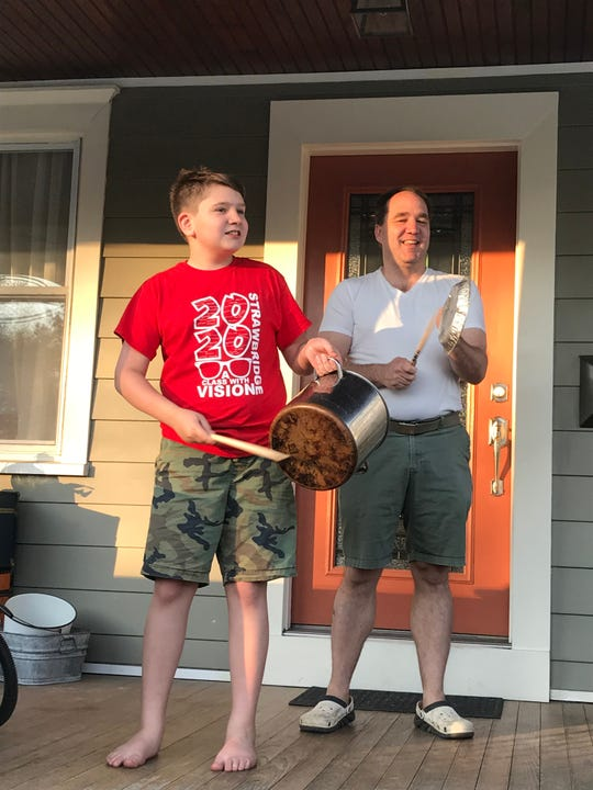 David Coughlin and son Callum  of Haddon Township beat on instruments of pots and pans on Tuesdays to applaud healthcare workers treating patients with the deadly coronavirus.