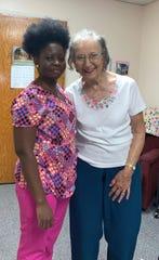 Elvira Attilio with an aide at the St. Joseph's Senior Home.