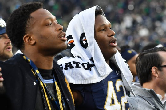 Notre Dame's Julian Okwara (42) and his brother, Detroit Lions player Romeo Okwara, sing the Notre Dame Alma Mater after the Irish defeated Bowling Green at Notre Dame Stadium, Oct. 5, 2019 in South Bend, Ind.