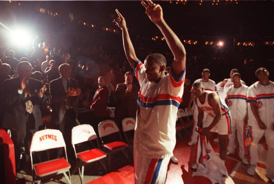 Pistons guard Isiah Thomas waves to the crowd after the starting lineup introductions in Thomas' final NBA game, April 19, 1994, at the Palace against the Magic.