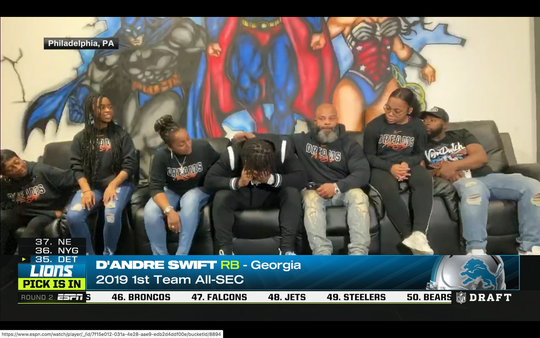 Screen shot from ESPN's coverage of the 2020 NFL draft, showing Georgia running back D'Andre Swift, center, and his family react to Swift getting drafted by the Detroit Lions on Friday, April 24, 2020.