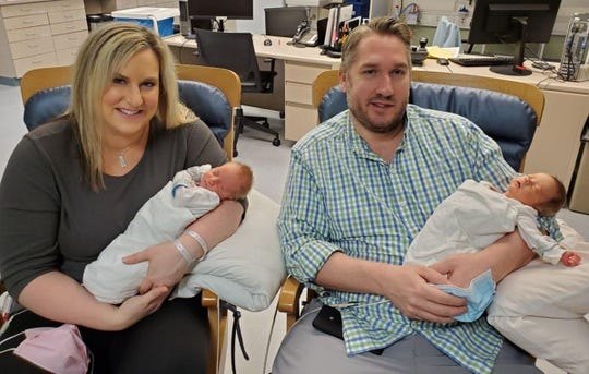 Jen Laubach holding Mitchell and her husband Andrew Laubach holding Maksim inside the neo-natal intensive care unit inside Troy Beaumont Hospital in Troy, Michigan on Friday, April 24, 2020.