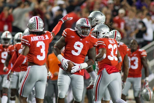 Ohio State defensive lineman Jashon Cornell (9) recovers the fumble in the first quarter against Oklahoma at Ohio Stadium, Sept. 9, 2017 in Columbus, Ohio.
