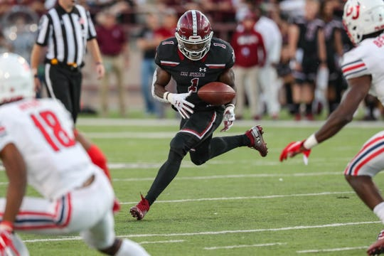 New Mexico State senior running back Jason Huntley runs the ball vs. Liberty on Saturday, Oct. 5, 2019 in  in Las Cruces, NM.
