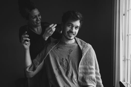 Konrad Tenwolde, a 31-year-old Michigan student from Ferndale, gets a haircut from his wife Jenna, a labor and delivery nurse at St. Joseph Mercy Oakland Hospital in Pontiac.