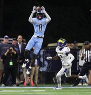 Rhode Island's Isaiah Coulter makes a catch vs. Delaware.