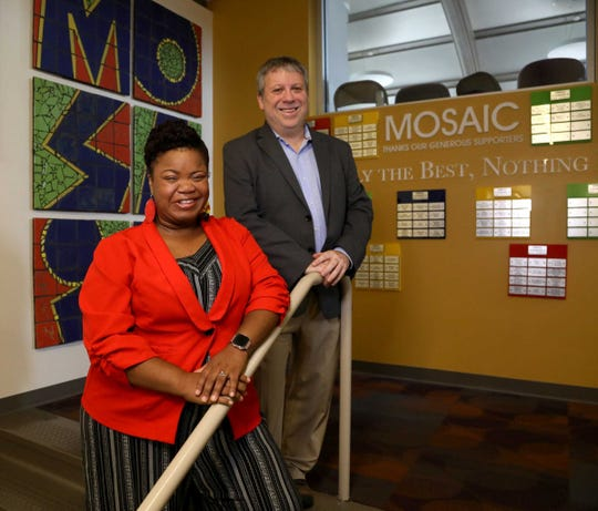 (L to R) Outgoing artistic director of the Mosaic Youth Theatre of Detroit Rick Sperling with the incoming artistic director DeLashea Strawder inside the Black Box Theater inside the facility in Detroit, Michigan on Tuesday, August, 13, 2019.