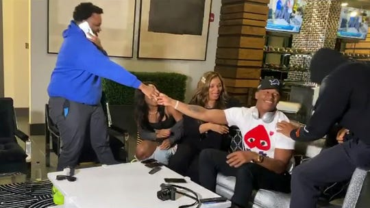 Julian Okwara, seated wearing cap, is congratulated after being selected by the Detroit Lions during the third round of the NFL draft, Friday, April 24, 2020.
