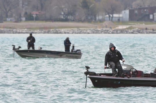 Fisherman cast their lines as motorized boating restarts along the Detroit River at Chene Park on Saturday, April 25, 2020. Max Ortiz, The Detroit News