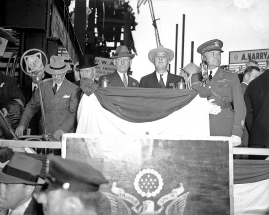 In this October 1936 photo, President Franklin Roosevelt at the new 21-story medical unit which he dedicated in Jersey City, N.J., assuring the medical profession that the New Deal contemplated no action detrimental to it in carrying out the Social Security Act. At left is Mayor Frank Hague of Jersey City and at right is military aide Lt. Col. E.M. Watson.