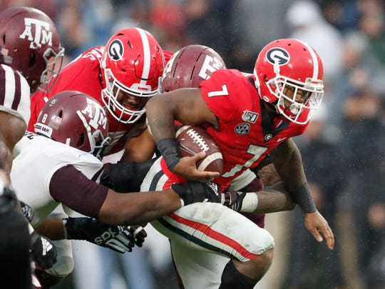 Georgia running back D'Andre Swift (7) struggles for extra yardage against Texas A&M in the first half of an NCAA college football game Saturday, Nov. 23, 2019, in Athens, Ga.