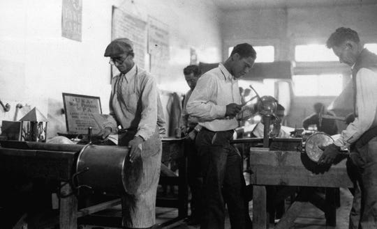 In this March 1937 photo, Works Progress Administration (WPA) workers make copper utensils for Pima County Hospital in Texas.  The New Deal was a try-anything moment during the Great Depression that remade the role of the federal government in American life.