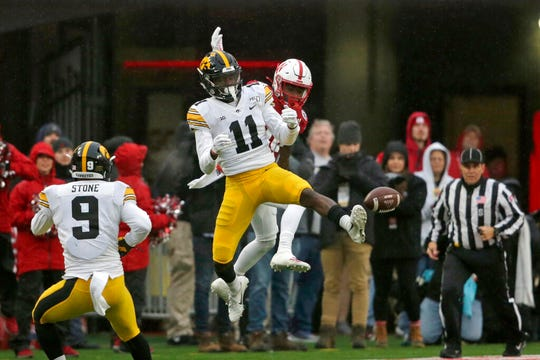 Iowa defensive back Michael Ojemudia (11), who played at Farmington Hills Harrison, was taken with the No. 77 overall pick.