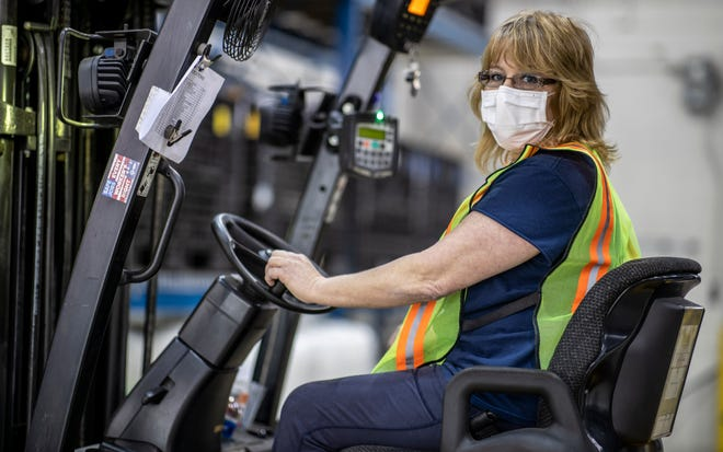 FILE - Cindy Parkhurst working at the Ford Flat Rock Assembly Plant in Flat Rock. Photo courtesy of Cindy Parkhurst.