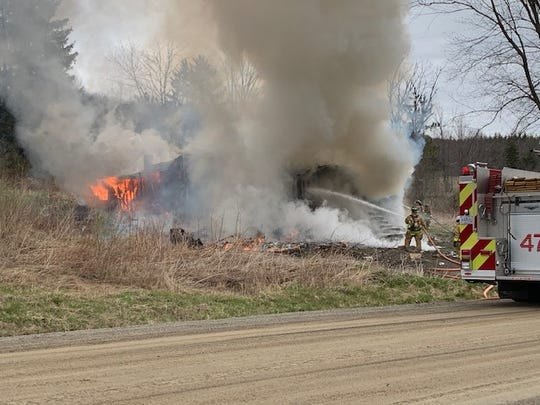 A fire broke out Saturday morning in Bath, destroying a house and garage.