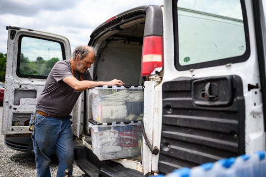 David Bailey packs up his van after spending the morning selling goods at the Anderson Jockey Lot Saturday, April 25, 2020.