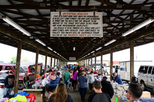 People check out outdoor booths at the Anderson Jockey Lot Saturday, April 25, 2020.