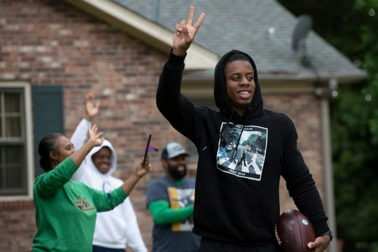 Troy Pride Jr. waves to a caravan of well wishers driving past his family's home in Greer Saturday, April 25, 2020. Pride was selected by the Carolina Panthers in the NFL Saturday.