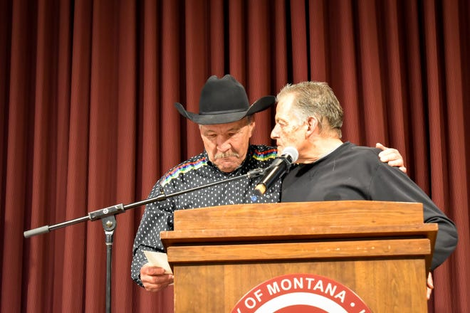 Don Wetzel, Sr. (right) and indigenous Vietnam War veteran Ronnie Bird share an embrace during the 2018 Montana Indian Athletic Hall of Fame at the University of Montana.