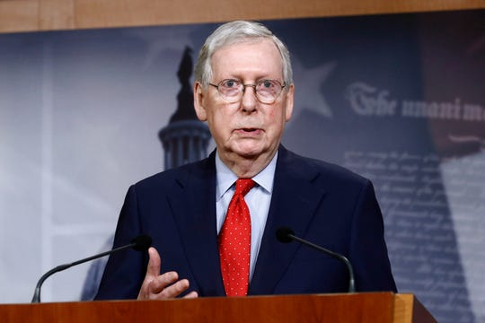 Senate Majority Leader Mitch McConnell of Ky., speaks Tuesday with reporters after the Senate approved a nearly $500 billion coronavirus aid bill.