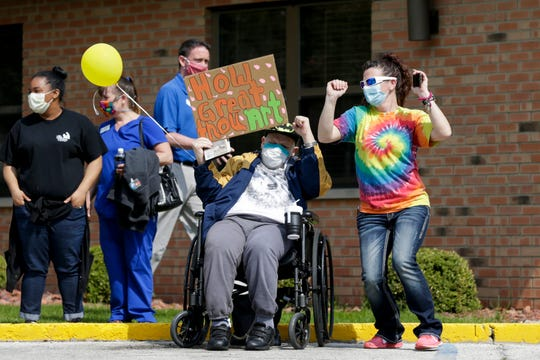 Cars file through Heritage Healthcare's parking lot to wave and show support for the nursing home's residents, Friday, April 24, 2020 in West Lafayette. We are all probably thinking more about senior citizens these days due to the threat posed by the coronavirus.
