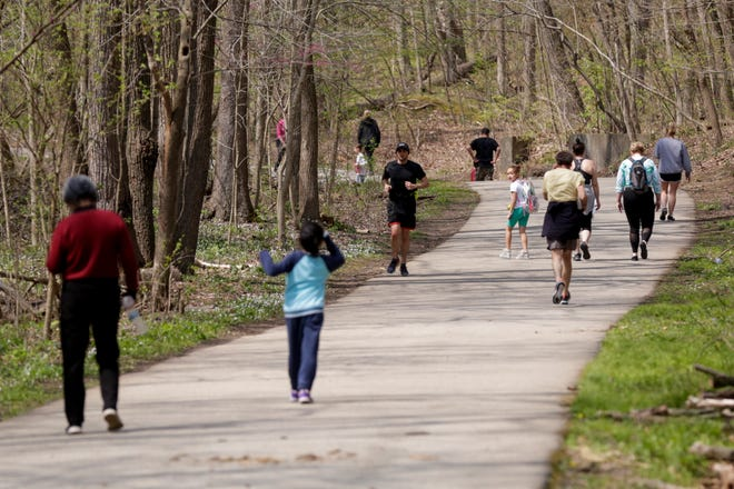 Multiple groups walk along the Wabash Heritage Trail in Happy Hollow Park, Friday, April 24, 2020 in West Lafayette.