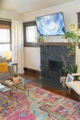 The living room's focal point is a brick fireplace and a flat-panel TV makes this room the hub of the home.