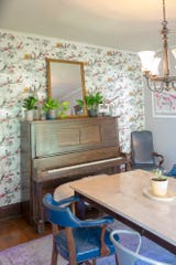 A piano resides in the dining room.