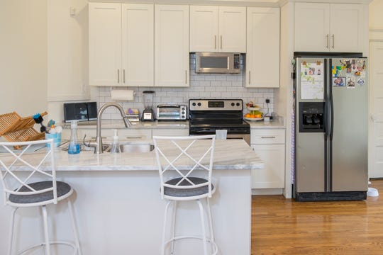 The modern kitchen is bright  and airy and offers a casual option.