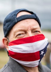 A Fox13 Memphis reporter poses wearing a hand made face mask in Memphis, Tenn., on Saturday, April 18, 2020.
