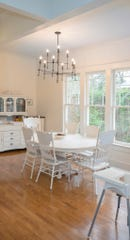 Removing three walls allowed the dining room and and kitchen area to be resized into much larger living spaces.