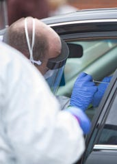Christ Community Health Center holds drive-through coronavirus testing on Frayser Boulevard, in Memphis, Tenn., on Saturday, April 25, 2020.